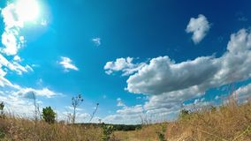 Landscape fields with path and moving clouds in blue sky. timelapse. Amazing rural valley. Ukraine stock footage