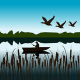 Landscape with fisherman in a boat Stock Photo