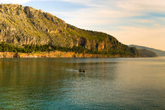 Landscape with a fishing boat against the beautiful scenic in Nafplio in Greece. Stock Photos