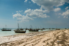 Landscape with fishing boats on the shore, Zanzibar royalty free stock photography