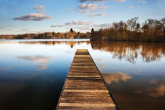Landscape of fishing jetty on calm lake Royalty Free Stock Images