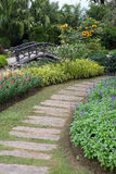 Landscape of floral gardening with pathway and bridge Royalty Free Stock Photos
