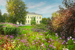 Landscape with flowers trees and building Royalty Free Stock Images