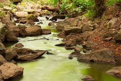 Landscape of flowing water and stones Royalty Free Stock Photos