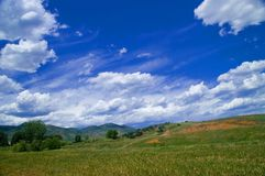 Landscape with fluffy clouds Royalty Free Stock Photos
