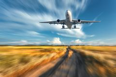 Landscape with flying passenger airplane and blurred blue sky royalty free stock photography
