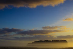 A landscape with fog and a sunrise Royalty Free Stock Images