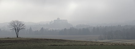 Landscape at fog with view to the renaissance palais Weitra Stock Photos