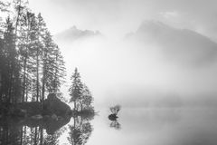 Landscape with Foggy Lake and Mountain Stock Photo