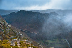 Landscape with foggy mountains with road Stock Photography