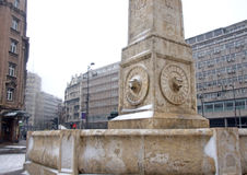 Landscape of a fontain with heads of lions in a snow day stock images