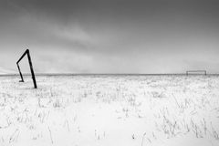 Football field in the snow. Landscape with football field in the snow Royalty Free Stock Images