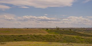Cloudy Foothills Landscape. Landscape of foothills with a cloudy sky Stock Image