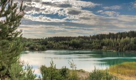 Landscape of the forest blue lake. On a quiet evening at sunset Royalty Free Stock Photo