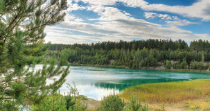 Landscape of the forest blue lake. On a quiet evening at sunset Royalty Free Stock Photography