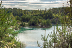 Landscape of the forest blue lake. On a quiet evening at sunset Royalty Free Stock Photos