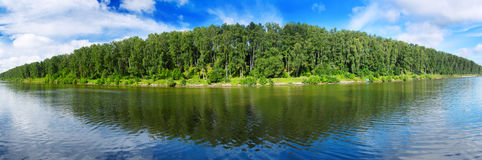Landscape of forest lake with reflections of clouds Stock Photography