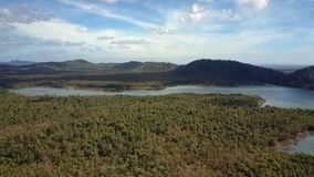 Landscape with Forest Long Lake and Distant Hills. Beautiful panoramic landscape with thick forest long calm lake distant hills on horizon against sky with white stock video