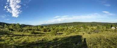 Landscape in the french Jura region with green meadows and blue. Panorama landscape in the french Jura region with green meadows and blue sky royalty free stock photography