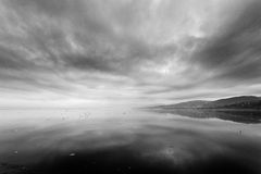 Frozen lake. Landscape with frozen lake and black clouds Royalty Free Stock Photos