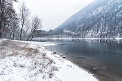 Landscape of frozen Lake Ghirla on a cold winter day, Province of Varese, Italy. Landscape of frozen Lake Ghirla on a cold winter day, Valganna, Province of stock photo
