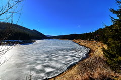 Landscape with frozen lake. Royalty Free Stock Image