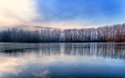 Landscape with frozen lake Stock Photography