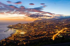 Landscape of Funchal, Madeira capital city, at sunset. A full sunset landscape of Funchal city, capital of Madeira islands with all the lights on and a city full Royalty Free Stock Images