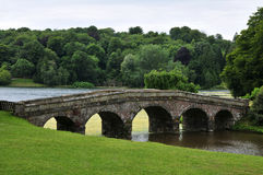 Landscape Garden. Beautiful Landscape Garden with and Old Stone Bridge and Trees in Full Leaf Royalty Free Stock Images
