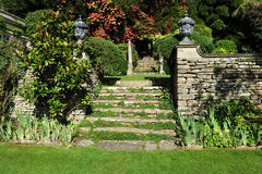 Landscape Garden. Grass Lawn and Stone Steps in a Peaceful English Landscape Garden Royalty Free Stock Images