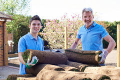Landscape Gardeners Laying Turf For New Lawn Royalty Free Stock Photography