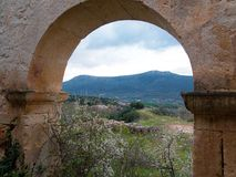 Landscape of Garoña framed in a stone arch. Landscape of Garoña framed in a stone arch of an old ruined building of an abandoned village in Burgos Stock Photos