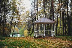 Landscape with gazebo and forest. Beautiful autumn landscape with gazebo and colorful forest Royalty Free Stock Photos