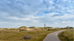 Landscape on German island Norderney. Situated in the North Sea with a lighthouse on the horizon stock photos