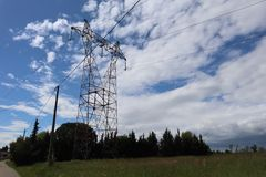Landscape with giant electric pylon stock photography