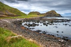 The rocky coast at Giant`s Causeway, Northern Ireland. Landscape of Giant`s Causeway in summer on Antrim coast, Northern Ireland Royalty Free Stock Image