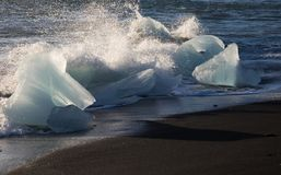 Landscape Glacial Icebergs on the Shore of Black Sand Diamond Beach in Iceland with Wave Royalty Free Stock Photography