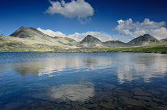 Landscape with glacial lake. And mountain peak Kamenica at national park Pirin, Bulgaria royalty free stock photography