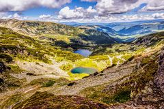 Landscape with a glacial lake in the highlands of Fagaras Stock Photo