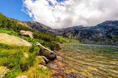 Landscape with a glacial lake in the highlands of Fagaras Royalty Free Stock Photos