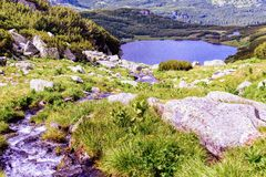 Landscape with a glacial lake in the highlands of Fagaras Stock Photos