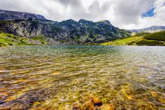Landscape with a glacial lake in the highlands of Fagaras Royalty Free Stock Photography