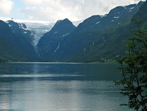 Landscape with a glacier. Mountain lake with a glacier above it Stock Images