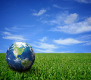 Landscape with globe Stock Photos