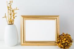 Landscape gold frame mockup with golden decor Stock Images