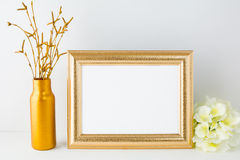 Landscape gold frame mockup Stock Image