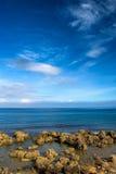Landscape of golden coral reef rock coastline stock photos
