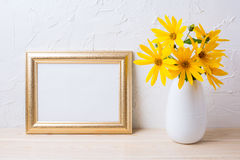 Landscape golden frame mockup with yellow rosinweed flowers Stock Image