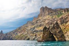 Landscape - Golden Gate Karadag, ship with people on a tour of the Black Sea, Crimea Stock Photo