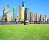 Landscape grass prospects the Shanghai Lujiazui city buildings o. F landmark sunny skyline Royalty Free Stock Image